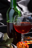 Wine and rose Stock Photography