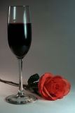 Wine and Rose. Red wine and single rose Royalty Free Stock Photography