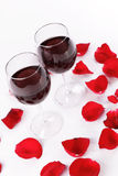 Wine and rose petals Stock Images