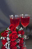 Wine and Roses. Two Glasses of Wine and Artificial Roses on a Black Background Royalty Free Stock Photos