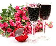 Wine and roses. On a white background Royalty Free Stock Images