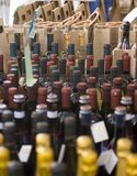 Wine for Sale. Rows of different types of wine are for sale in an open market in Northern Italy royalty free stock image