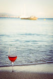 Wine in the sand. Capturing the wine on the beach stock photo
