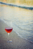 Wine in the sand. Capturing the wine on the beach royalty free stock images