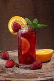 Wine of Sangrija in a transparent glass with a strawberry, an or. Ange and mint royalty free stock photography