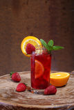 Wine of Sangrija in a transparent glass with a strawberry, an or. Ange and mint stock image