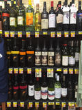 Wine section of a Grocery Store. The wine section of a grocery stores shows many different vintages and styles of wine Royalty Free Stock Photo