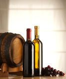 Wine selection with barrel and grapes Stock Photography
