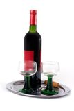 Wine is served. A bottle of red wine, two glasses and a corkscrew lying on a silver tray Stock Photo