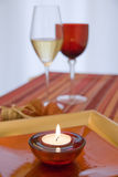 Wine setting and candle Stock Photos