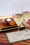 Wine setting and candle Stock Images