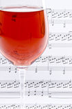 Wine and Sheet Music Royalty Free Stock Image