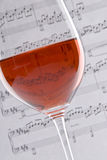 Wine and Sheet Music Stock Photography