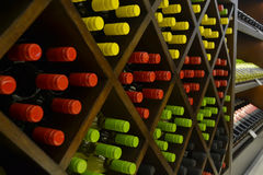 Wine shelf. Kinds of wine bottles on a shelf Royalty Free Stock Images