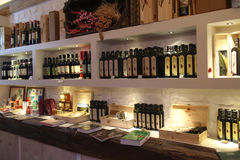 Wine shop. Interior of a shop selling olive oil and wines known as Sagrantino. The Sagrantino wines and the olive oil  are produced in the area of Montefalco Stock Photography