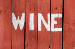 Wine Sign. The word Wine is painted on the side of old barn boards Royalty Free Stock Photos