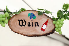 Wine sign. With green grapes decorating Royalty Free Stock Photo
