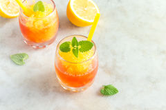 Wine Slush. Frozen Granita Wine Slush Drink on rustic stone table. Homemade Italian Granita Dessert, refreshing  summer Gradient Tropical Slush Drink with mint Royalty Free Stock Photos