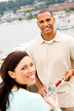 Wine: Smiling Man And Woman About To Share Glass Of Wine royalty free stock images