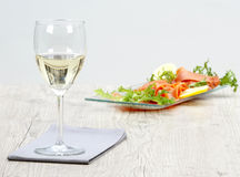 Wine and smoked salmon stock images