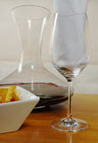 Wine with Snack. Wineglass with napkin, snack and red wine (Selective Focus Stock Image