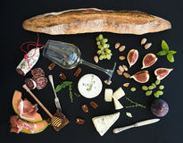 Wine and snack set. Baguette, glass of white, figs Royalty Free Stock Photo