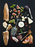 Wine and snack set. Baguette, glass of white, figs Stock Images