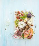 Wine and snack set. Figs, grapes, nuts, cheese Royalty Free Stock Photos