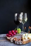 Wine snack set. Glass of red and white wine, grape, cheese, over royalty free stock photography