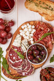 Wine snack set. Variety of cheese and meat, olives, grapes, arug Stock Images