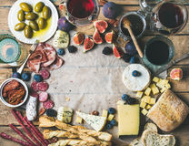 Wine and snack set with wines, meat, bread, olives, fruits Royalty Free Stock Photos