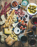 Wine and snack set with wines, meat, bread, olives, fruits Stock Photography