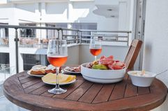Wine with snack the summer terrace Stock Images
