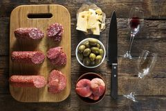 The Italian table. French cuisine. European traditions.Wine and snacks.  View from above, rustic style. Wine and snacks. The Italian table. French cuisine Royalty Free Stock Photos