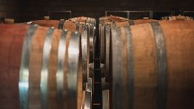 Wine soaked barrels in the Cellar. Red Wine soaked wooden barrels in the cellar of a Chianti Region Winery in Italy royalty free stock image