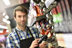 Wine specialist giving advice on wine Stock Photography