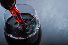 Wine spill in glass Royalty Free Stock Image
