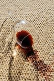 Wine spill on a wool carpet. A glass of red wine spilt on a wool carpet royalty free stock photo