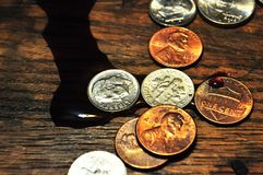 Wine spilled over on to US coins stock photography