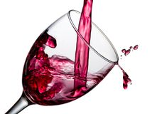 Wine splash with drops Stock Images
