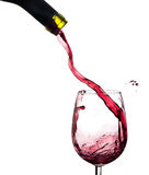 Wine splash on a glass, white background. Royalty Free Stock Photos