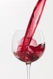 Wine splash on white background Stock Photography
