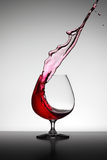 Wine splashed in Glass. Wine splahed in glass red Royalty Free Stock Image