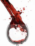 Wine splashes. In glass. isolated on white royalty free stock image