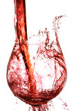Wine splashing in glass. Isolated on white Stock Photo
