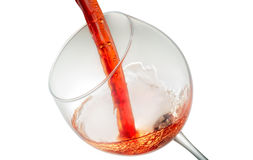 Wine splashing on glass Stock Images