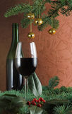 Wine and sprig of holly Royalty Free Stock Photos