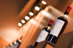 Wine stand with bottles Royalty Free Stock Photo