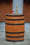 Wine standing on a wooden barrel Royalty Free Stock Image