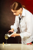 Wine steward fills glass. Alcohol liquor drinking tasting relax concept. Wine steward fills glass. Young male waiter pours drink into cup Stock Photography